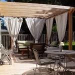 Pergola Addossata con tendaggi da giardino